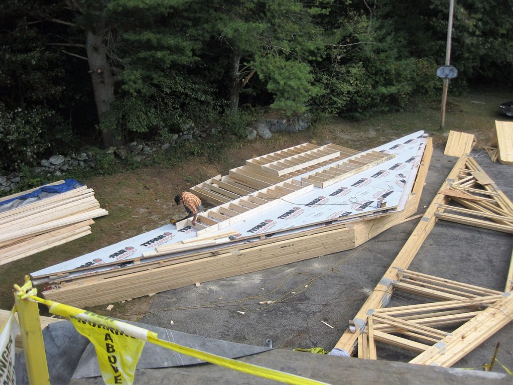 Working on roof frame for new house