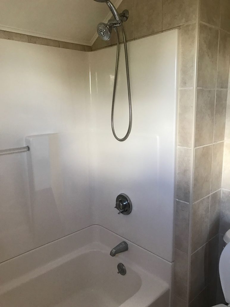 New bathtub with a spa showerhead