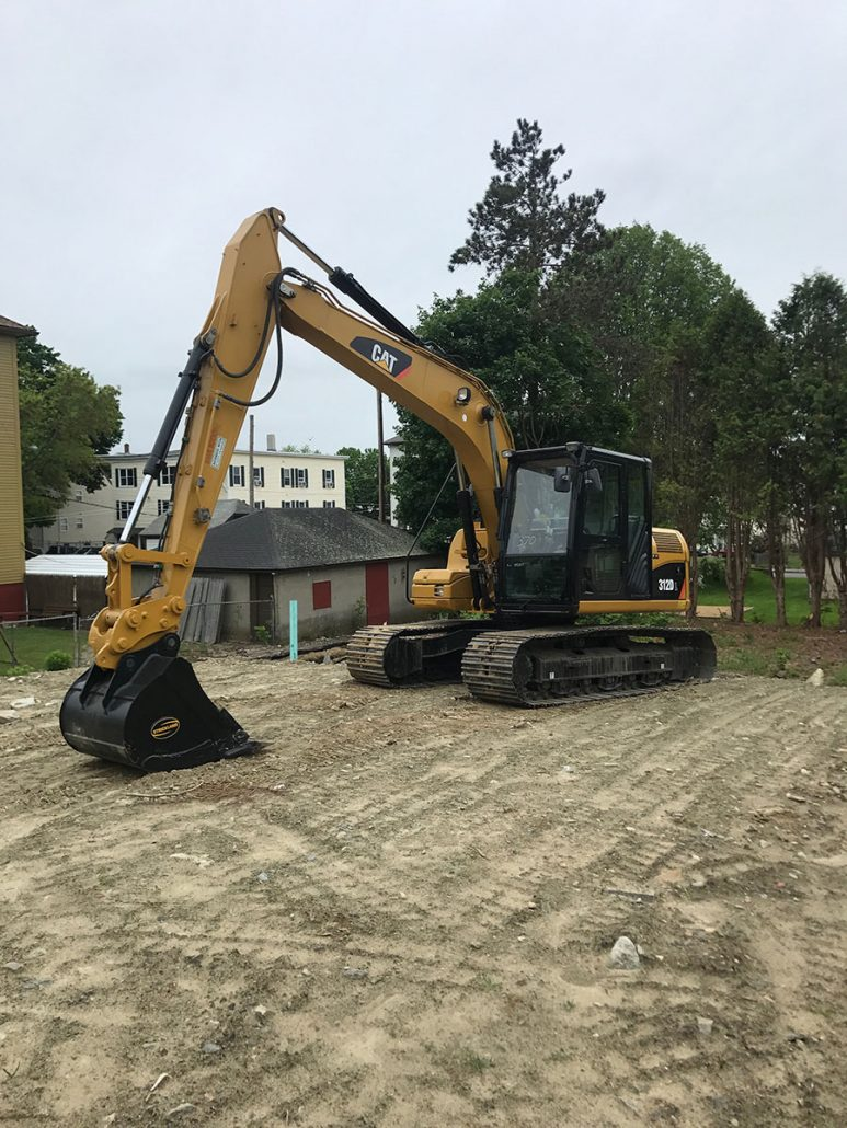 Excavator on newly filled lot