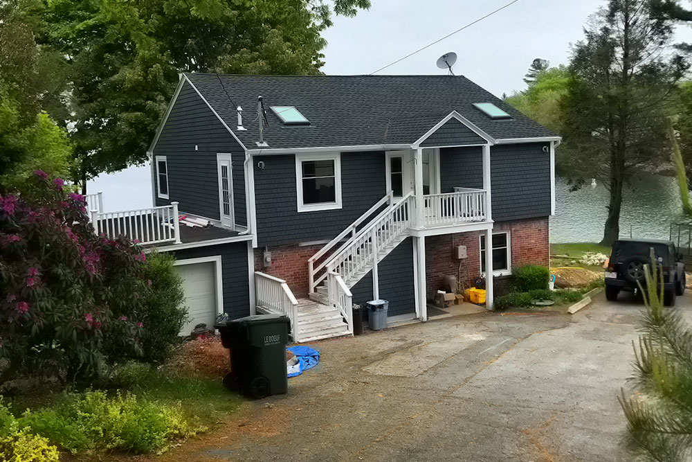 Renovated home with new roof, siding, and front porch